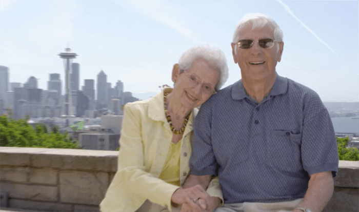 An elderly couple smiles in Seattle
