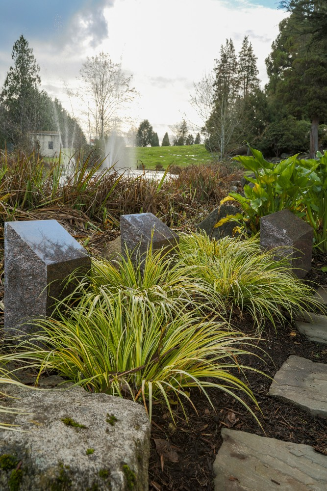 Granite markers on well-manicured lawn in Lakeside Cremation Garden